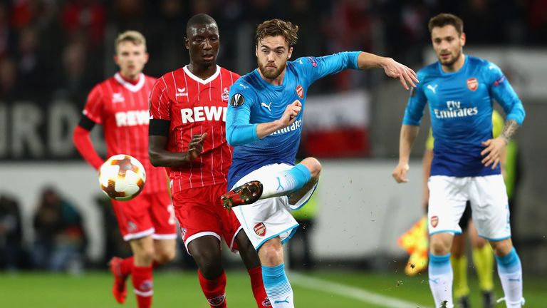 Arsenal defender Calum Chambers and Cologne's Sehrou Guirassy in action
