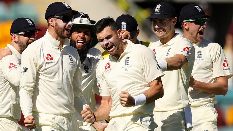 BRISBANE, AUSTRALIA - NOVEMBER 24:  James Anderson of England celebrates with team mates after a successful DRS appeal for the dismissal of Peter Handscomb