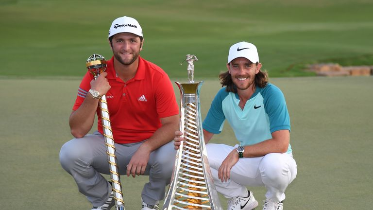 DUBAI, UNITED ARAB EMIRATES - NOVEMBER 19:  Jon Rahm of Spain poses with the trophy and Tommy Fleetwood of England poses with the Race to Dubai trophy duri