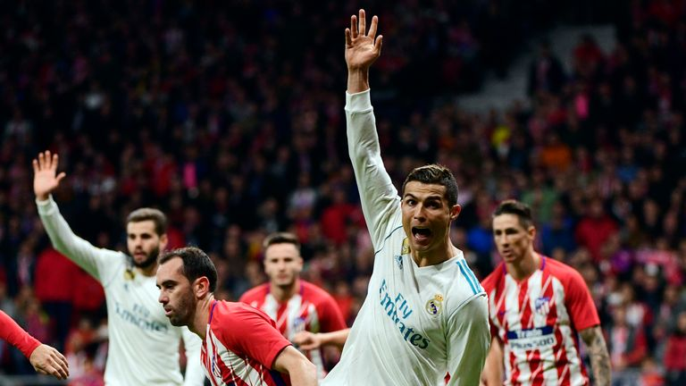 Real Madrid's Portuguese forward Cristiano Ronaldo (2R) gestures during the Spanish league football match Atletico Madrid vs Real Madrid at the Wanda Metro