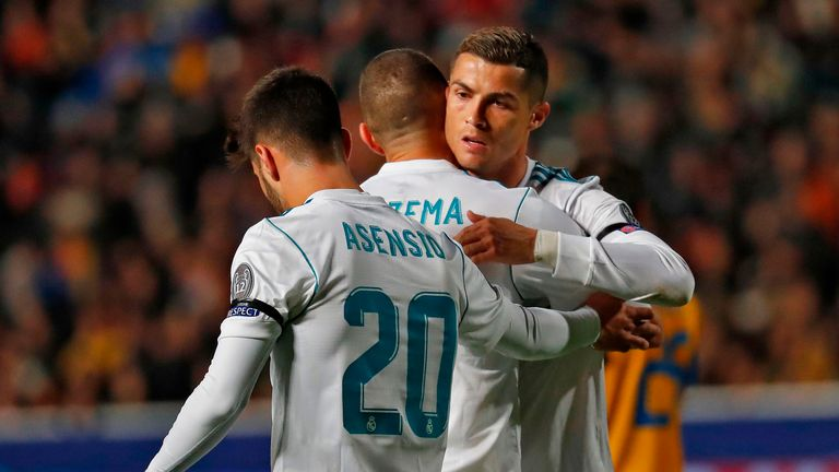 Real Madrid's French forward Karim Benzema (L) hugs teammate Real Madrid's Portuguese forward Cristiano Ronaldo after scoring a goal