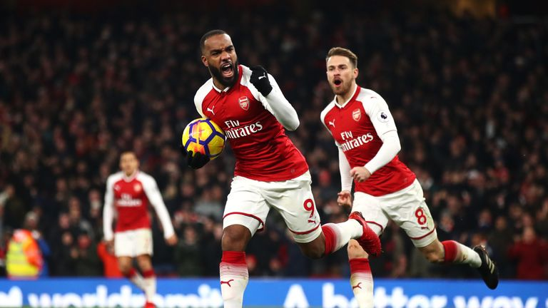 Alexandre Lacazette celebrates after scoring Arsenal's first goal