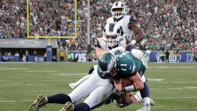 Eagles QB Carson Wentz injures his knee as he attempts to break into the endzone for a touchdown