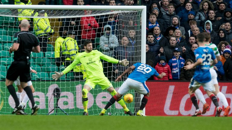 Celtic goalkeeper Craig Gordon pulls off a save to deny Alfredo Morelos