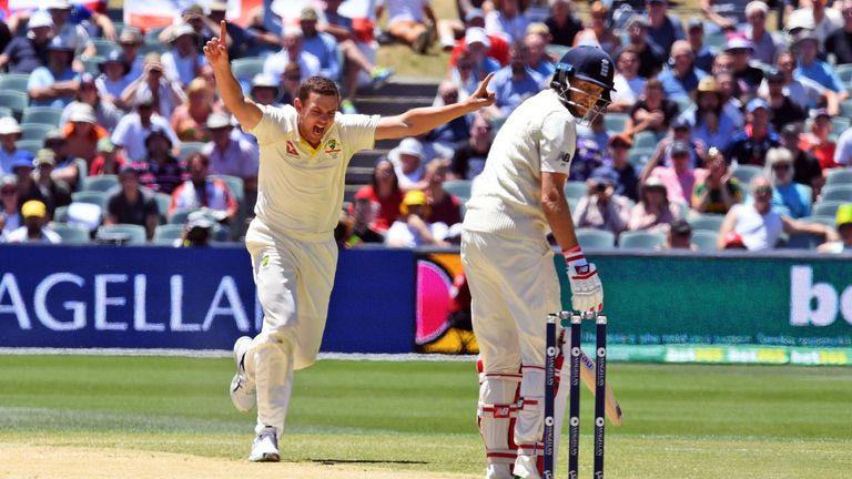 Josh Hazlewood (L) celebrates dismissing England captain Joe Root (R)