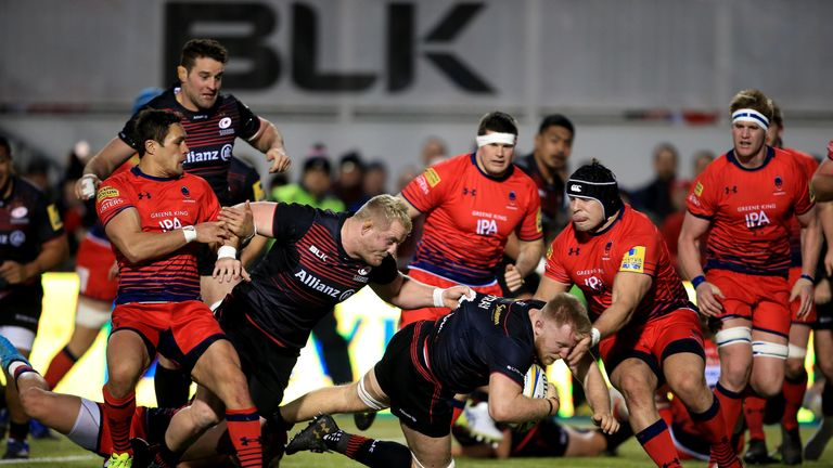 Jackson Wray of Saracens dives over for a try