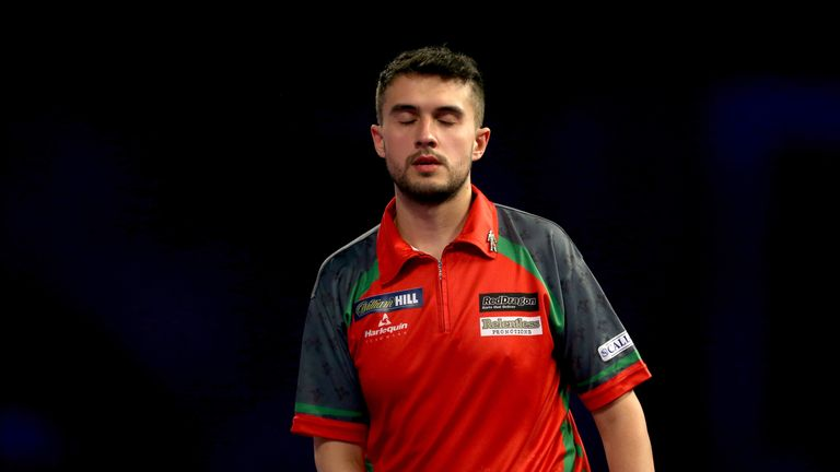 Lewis reacts during his World Championship semi-final defeat to Taylor