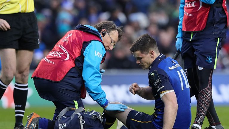 Leinster's Johnny Sexton receives attention after he was injured in the early stages of the match