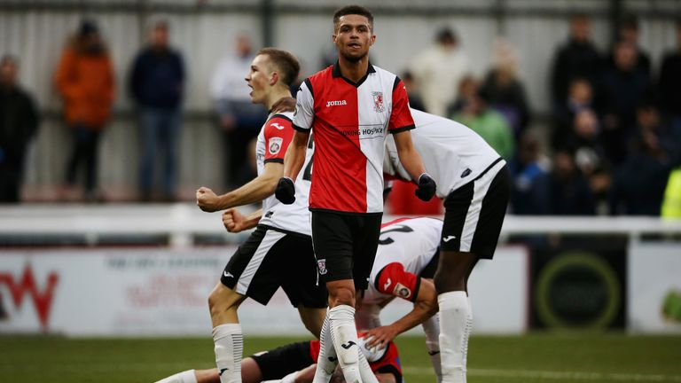Kane Ferdinand of Woking celebrates Joe Ward's goal against Peterborough