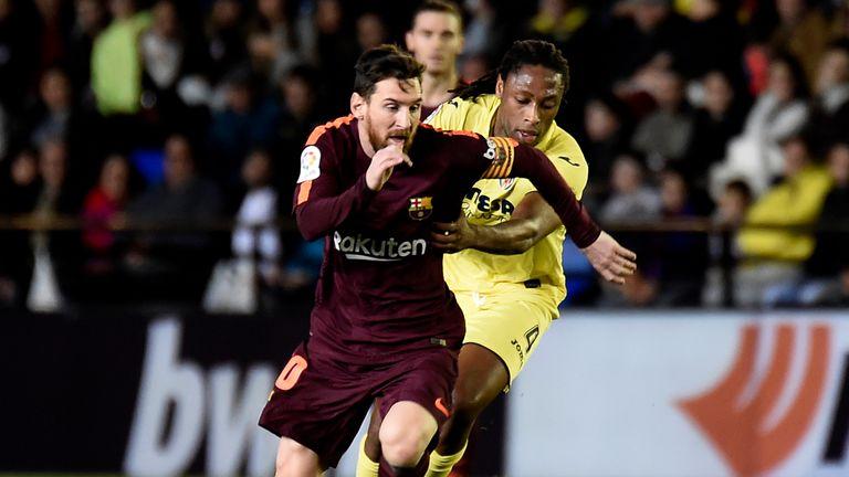 Lionel Messi vies with Villarreal's Ruben Semedo