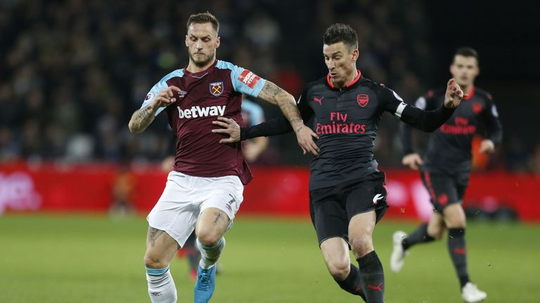 Marko Arnautovic and Laurent Koscielny in action at the London Stadium