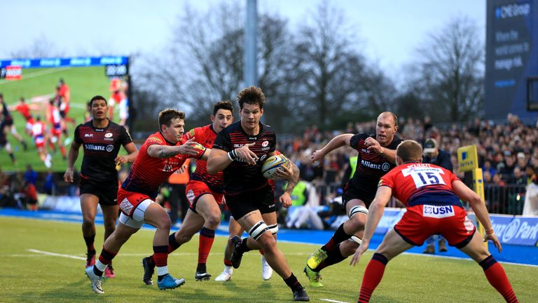 Michael Rhodes of Saracens runs at the Worcester defence