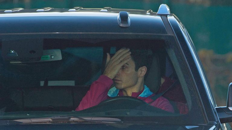 Assistant coach Mikel Arteta covered his face as he arrived for Man City training on Monday (Pic credit: Cavendish Press)