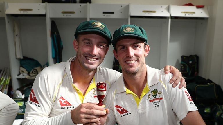 Mitchell Marsh (right) celebrates regaining the Ashes alongside  brother Shaun