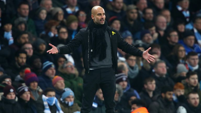 Pep Guardiola has been charged by the FA for wearing a political message
