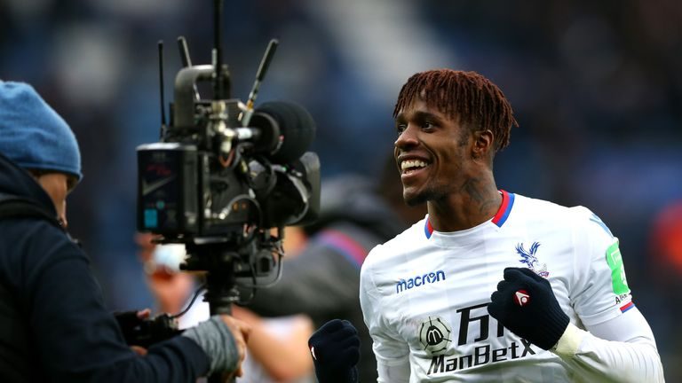 Wilfried Zaha celebrates the 3-0 victory over Leicester City