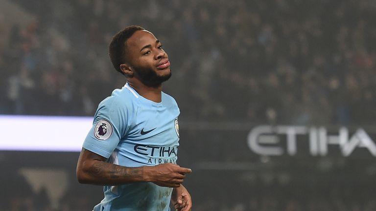 Raheem Sterling celebrates after scoring City's third