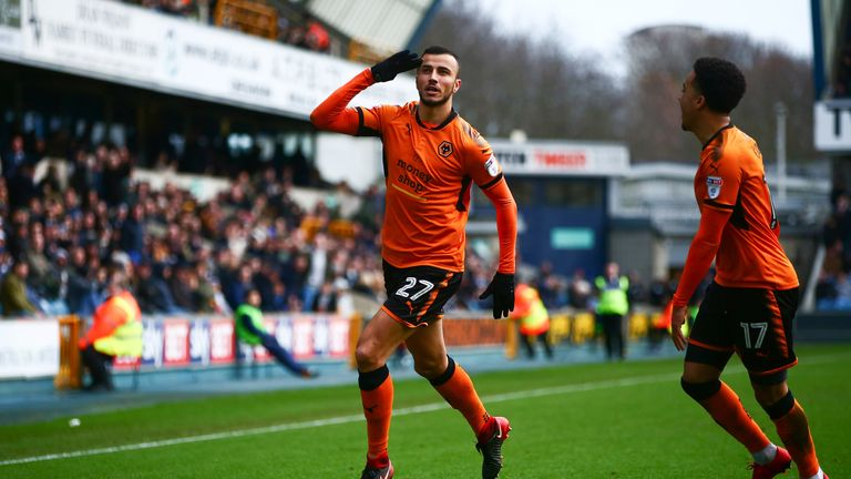 Romain Saiss celebrates after making it 2-1 to Wolves at The Den