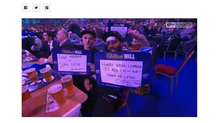 Trippier (left) and Rose held up messages at the darts