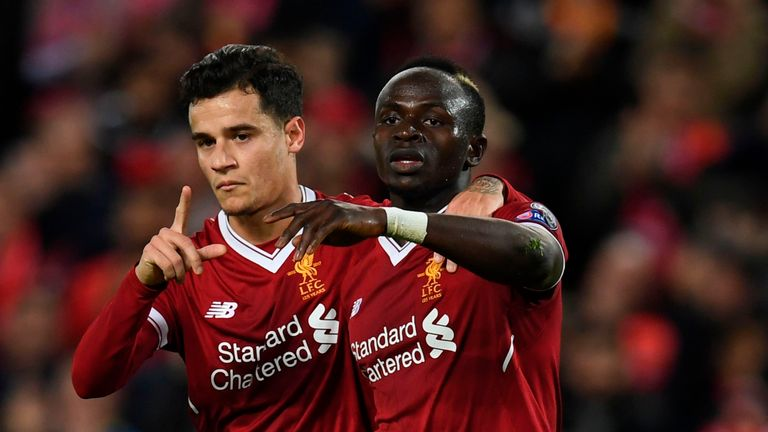 Sadio Mane (right) celebrates with Philippe Coutinho