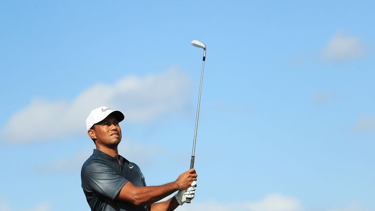 Woods is 10 shots off the lead, but he is happy to be back in competition