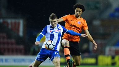Lewis Montrose of AFC Fylde and Max Power of Wigan Athletic in action during the FA Cup second-round replay.