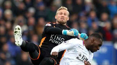 LEICESTER, ENGLAND - DECEMBER 16:  Christian Benteke of Crystal Palace clashes with Kasper Schmeichel of Leicester City during the Premier League match bet