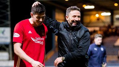 Derek McInnes (right) is keen to keep Scott McKenna at Aberdeen