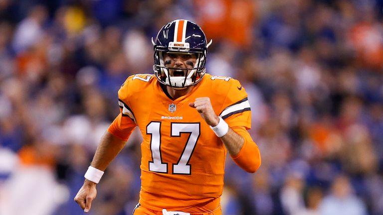 INDIANAPOLIS, IN - DECEMBER 14:  Brock Osweiler #17 of the Denver Broncos reacts against the Indianapolis Colts during the first half at Lucas Oil Stadium