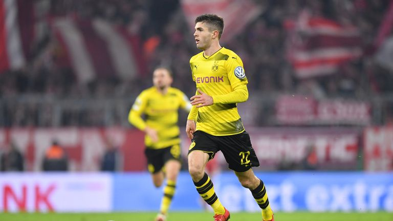 Christian Pulisic of Dortmund plays the ball during the DFB Cup match between Bayern Munich and Borussia Dortmund