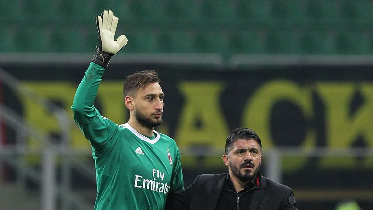 MILAN, ITALY - DECEMBER 13:  Gianluigi Donnarumma of AC Milan and AC Milan coach Gennaro Gattuso salute the crowd at the end of the Tim Cup match between A