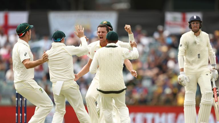 Josh Hazlewood of Australia celebrates after taking the wicket of Craig Overton of England  during day five of the Third Test