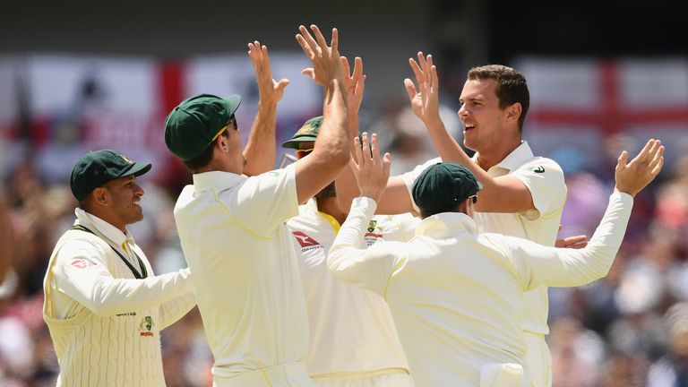 PERTH, AUSTRALIA - DECEMBER 17:  Josh Hazlewood of Australia is congratulated by team mates after taking the wicket of Mark Stoneman of England during day