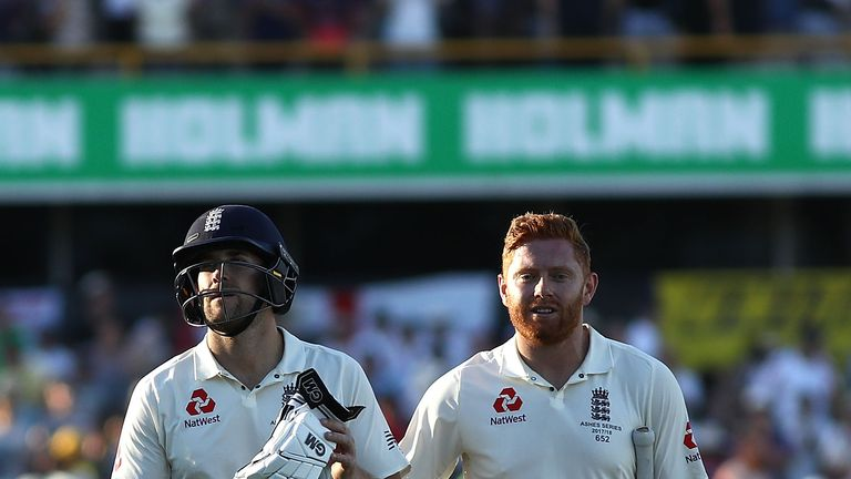 PERTH, AUSTRALIA - DECEMBER 14:  Dawid Malan and Jonny Bairstow of England leave the ground at stumps on 110 not out during day one of the Third Test match