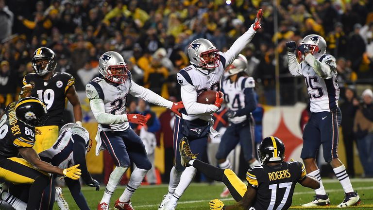 PITTSBURGH, PA - DECEMBER 17: Duron Harmon #30 of the New England Patriots intercepts a pass thrown by Ben Roethlisberger #7 of the Pittsburgh Steelers in