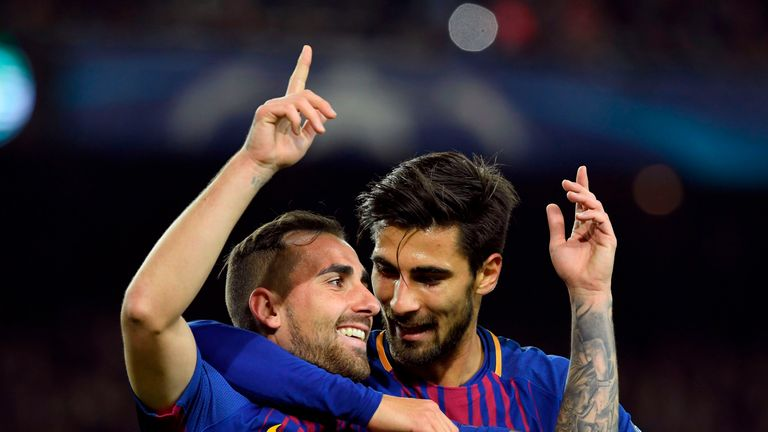 Barcelona's Spanish forward Paco Alcacer (L) celebrates with Barcelona's Portuguese midfielder Andre Gomes after scoring a goal during the UEFA Champions L
