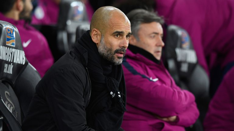 Pep Guardiola looks on from the touchline at the Liberty Stadium