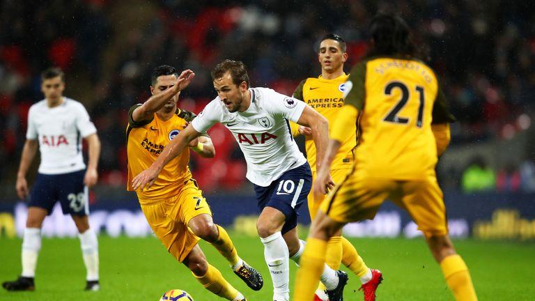 Harry Kane runs at the Brighton defence