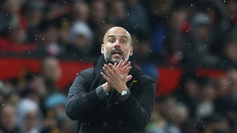 Pep Guardiola gives his team instructions from the touchline