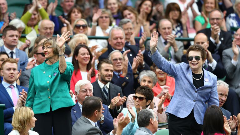 Margaret Court (l) and Billie Jean King (r) wave to the crowd at Wimbledon in 2016