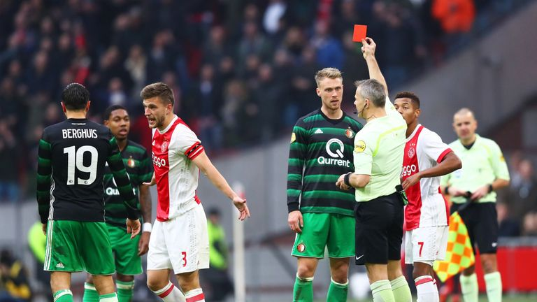 Nicolai Jorgensen of Feyenoord is shown a red card by referee Bjorn Kuipersduring