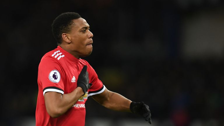 Anthony Martial thumps his chest after scoring the opening goal