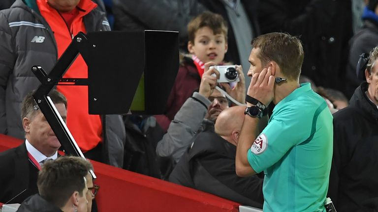 Referee Craig Pawson looks at the pitch-side screen after speaking to the VAR (Video Assistant Referee) before giving Liverpool a penalty