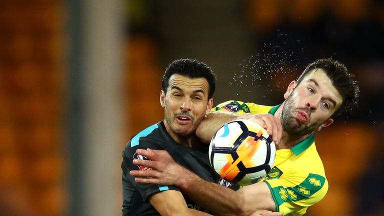 Chelsea's Pedro (L) competes for possession with Grant Hanley