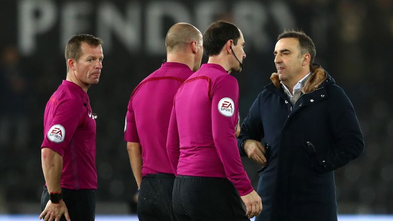 Carlos Carvalhal protests with referee Bobby Madley and the two assistants after the full-time whistle