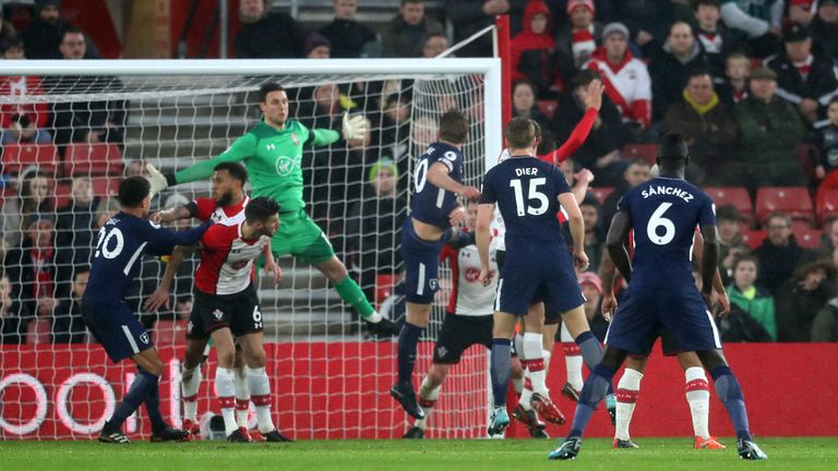 Kane (centre) scores his side's equaliser against Southampton