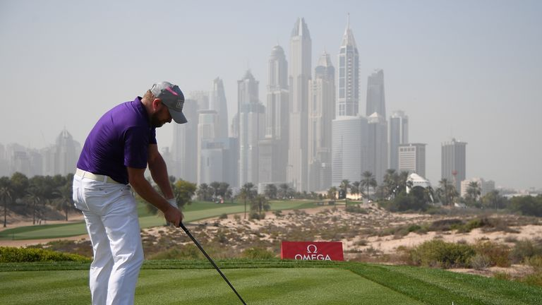 McIlroy hot in late stages of 2nd round to take Dubai lead