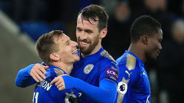 Marc Albrighton celebrates scoring Leicester's third goal with Christian Fuchs