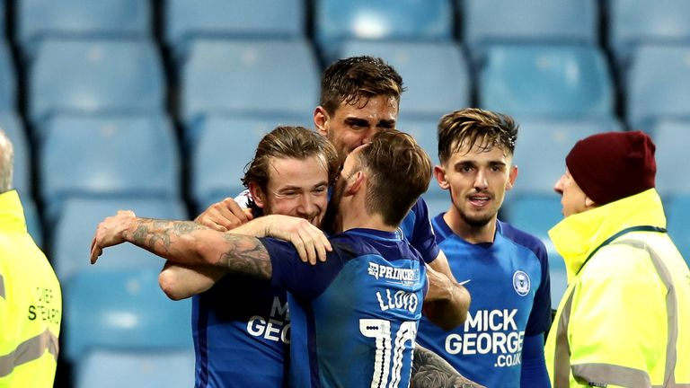 Peterborough's Dan Lloyd-McGoldrick congratulates goalscorer Jack Marriott