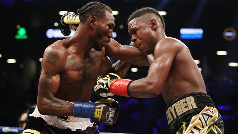 Robert Easter Jr. (left) and Javier Fortuna exchange punches  during their IBF lightweight title bout